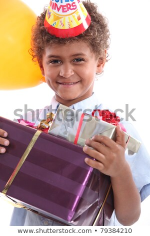 a little boy holding a conical hat and birthday gifts in his arms Stock photo © photography33