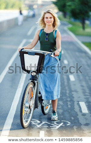 smiling young blonde in denim skirt stock photo © acidgrey