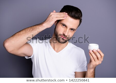 Man applying product to style hair Stock photo © photography33