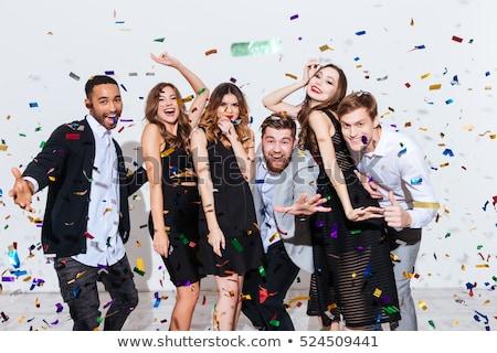 Cuatro personas feliz gafas traje champán Foto stock © photography33