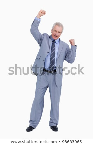 Cheering mature tradesman with arm risen against a white background Stock photo © wavebreak_media
