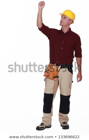 Mason pulling invisible object Stock photo © photography33