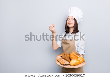 Young female chef offering pastry Stock photo © wavebreak_media