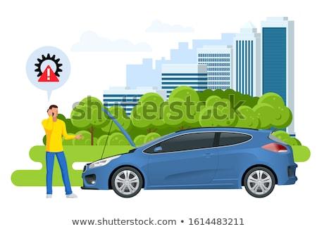 Businessman repairing car roadside Stock photo © stockyimages