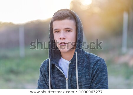 Stockfoto: Casual Man Sits Outside And Looks At You