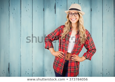young fashion blonde woman with hands on hips stock photo © feedough