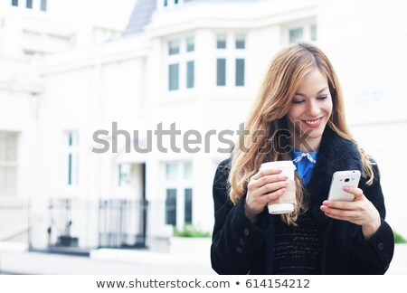 Happy businesswoman talking on the cellphone in a coffee house stock photo © vlad_star