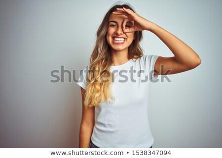 happy hispanic woman doing ok sign with hand Stock photo © diego_cervo
