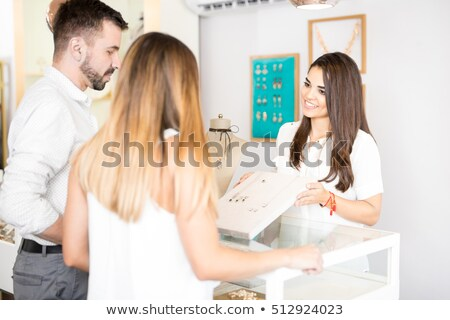 Young Woman Working In Jewelry Shop Stock photo © AndreyPopov