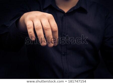 Hand man gadget iets walgelijk Stockfoto © fotoaloja