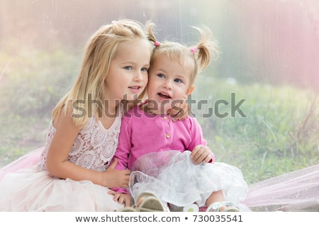 two little sisters having fun in summer park stock photo © hasloo