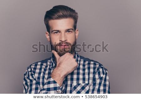joven · tocar · largo · barba · moda · mirando - foto stock © feedough