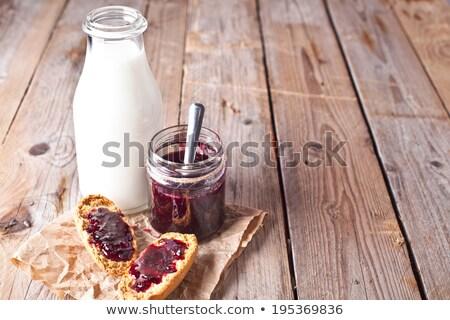 Siyah frenk üzümü reçel cam kavanoz süt Stok fotoğraf © marylooo