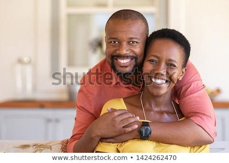 smiling couple on black stock photo © zastavkin