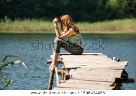 Belle fille séance herbe lunettes de soleil femme beauté Photo stock © PetrMalyshev