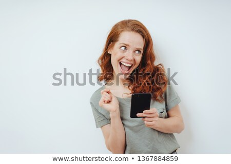 Vivacious woman reacting to a text message Stock photo © juniart