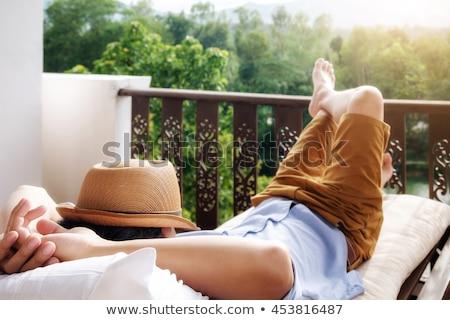 Fiatalember pihen kívül portré vonzó Stock fotó © fatalsweets