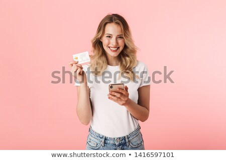 beautiful blonde woman with phone and credit card stock photo © feverpitch