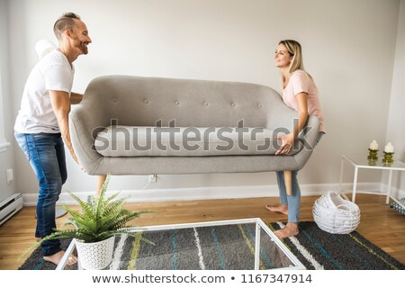 Couple carrying a sofa Stock photo © ambro