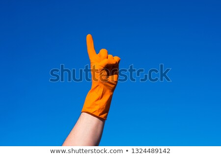 Two hands in red gloves against  blue sky Stock photo © Paha_L