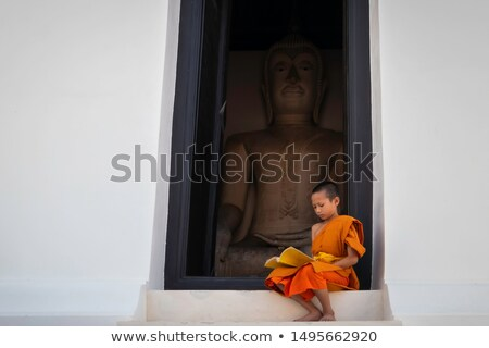 Buddhist novice monks inside temple Stock photo © szefei