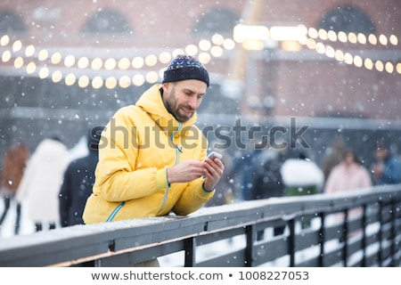 Mobile phone in hands with glowes, cold weather Stock photo © adamr