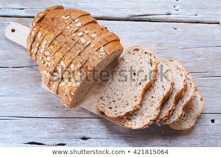 slices of buckwheat bread on cutting board top view stock photo © stevanovicigor