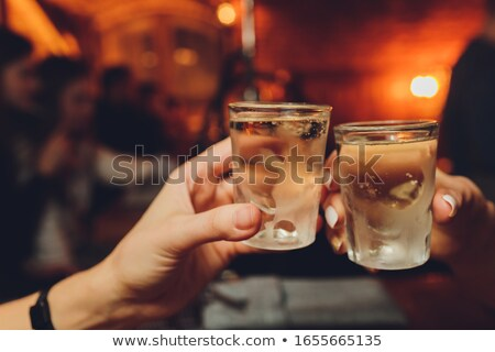 cheers man drinks alcohol cocktail party Stock photo © studiostoks