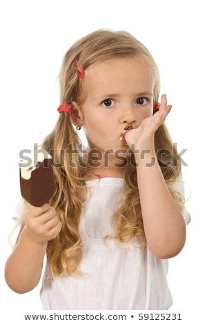 a little kid is sucking an ice cream stock photo © zurijeta