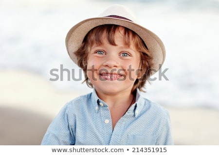 Handsome man in hat summer outdoor portrait close up. Vacation.  Stock photo © Victoria_Andreas