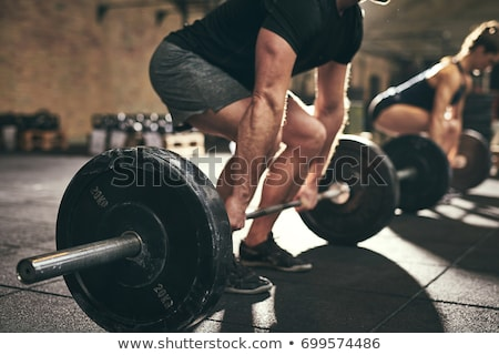 Súlyemelés emberek dolgoznak ki tornaterem férfi jókedv Stock fotó © bluering