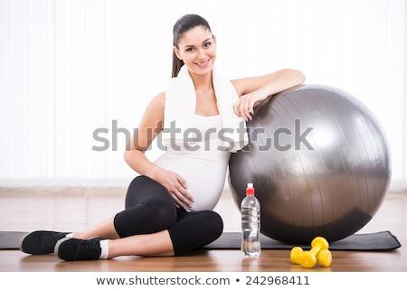 Pregnant woman on gymnastic ball. Stock photo © RAStudio