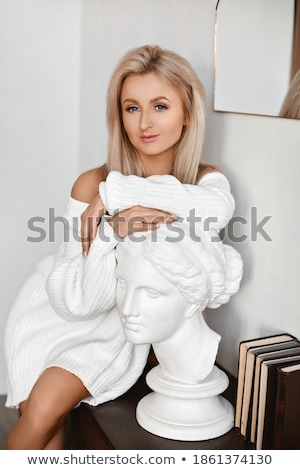 Young blond lady in a seductive pose Stock photo © konradbak