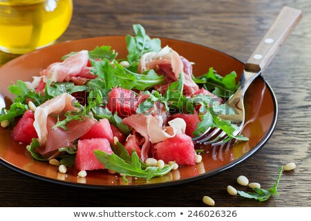 Melon salade prosciutto fraîches régime alimentaire bol Photo stock © M-studio