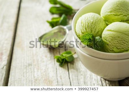 Scoop of green ice cream on plate Stock photo © Digifoodstock