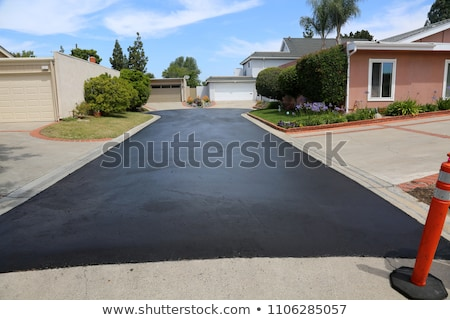 Unidentifiable road maintenance worker repairing driveway Stock photo © stevanovicigor