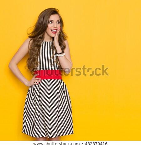 Mooie vrouw poseren zwarte jurk handen heupen Stockfoto © deandrobot