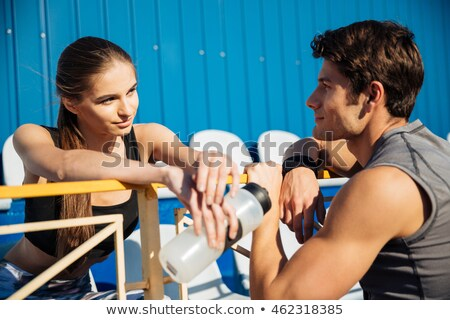 close up portrait of young couple talking at the stadium stock photo © deandrobot