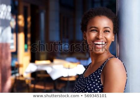 Portret młoda kobieta stałego czarna sukienka odizolowany Zdjęcia stock © deandrobot