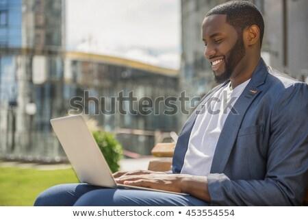feliz · jóvenes · África · hombre · mirando · foto - foto stock © deandrobot