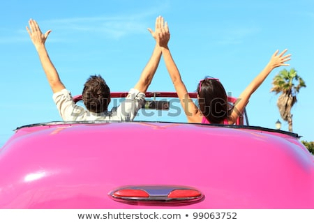 Two young happy girls driving a cabriolet Stock photo © vlad_star