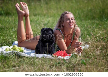 Woman in swimsuit with dog pug Stock photo © yuriytsirkunov