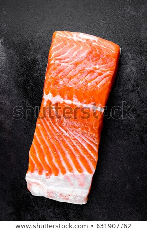 raw salmon or trout sea fish fillet on black metal background top view stock photo © yelenayemchuk