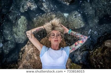 Hermosa niña mar agua rocas mitad desnuda Foto stock © andreonegin