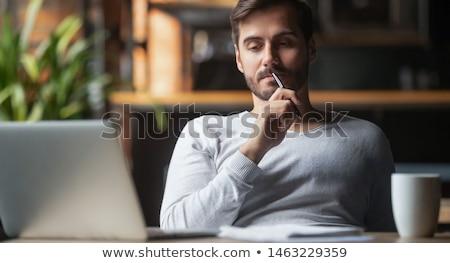 fiatalember · megérint · arc · szürke · arckifejezés · emberek - stock fotó © filipw