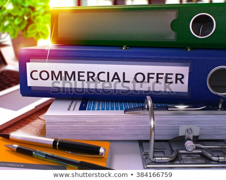 commercial offer on blue office folder toned image stock photo © tashatuvango