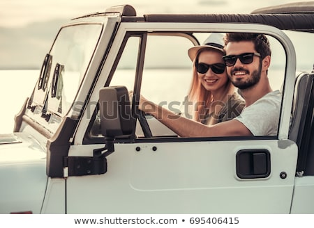 Man and woman driving in a jeep Stock photo © IS2