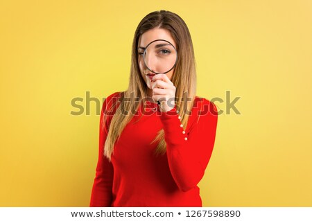 Young hispanic detective with magnifying glass. Stock photo © RAStudio