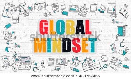 multicolor global thinking on white brickwall doodle style stock photo © tashatuvango