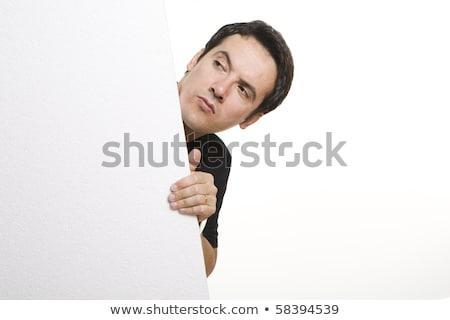 Joven ocultación detrás blanco hombre Foto stock © wavebreak_media